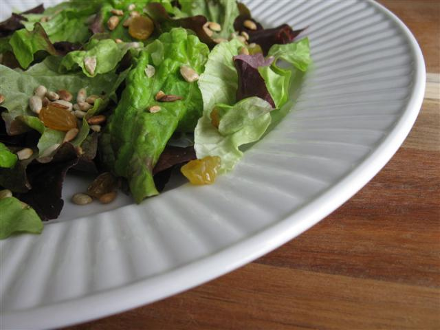 Mixed herb salad with toasted nuts and seeds